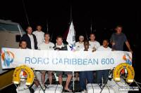 Nick Bate and the crew of the Army Sailing Association's A40, British Soldier celebrating at the finish of the RORC Caribbean 600. Photo: RORC/Tim Wright