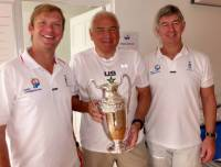 Hap Fauth presenting the trophy to Eddie Warden Owen and Nick Elliott from the RORC