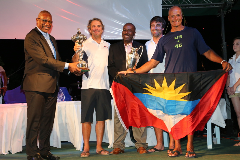 The crew of Bella Mente are presented with the RORC Caribbean Trophy for IRC Overall. Credit: RORC/Tim Wright/www.photoaction.com