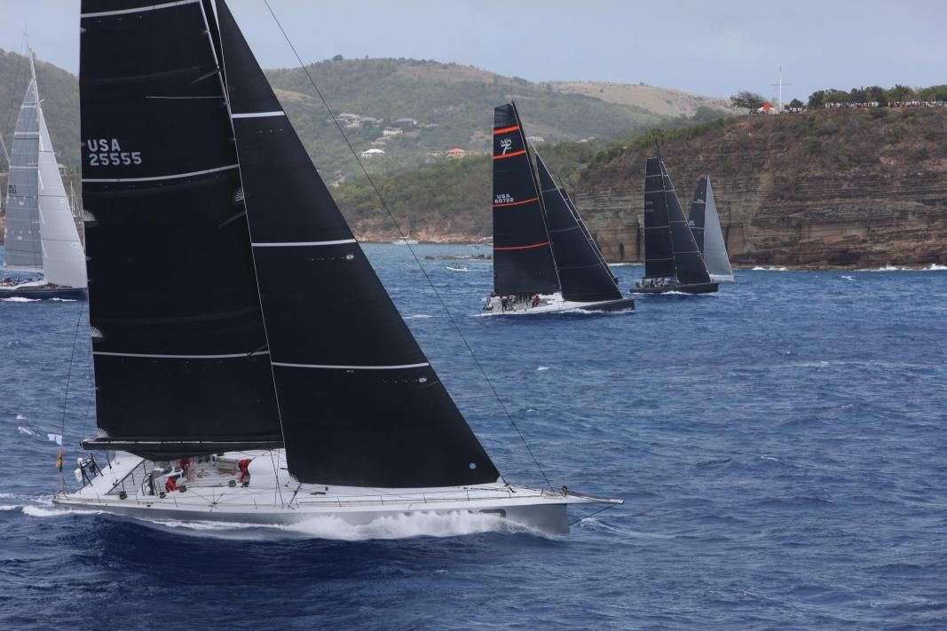 On record pace, George David's American Maxi Rambler 88 and the IRC Zero & Superyacht fleet at the start of the RORC Caribbean 600 off Fort Charlotte in Antigua today © RORC/Tim Wright/Photoaction.com
