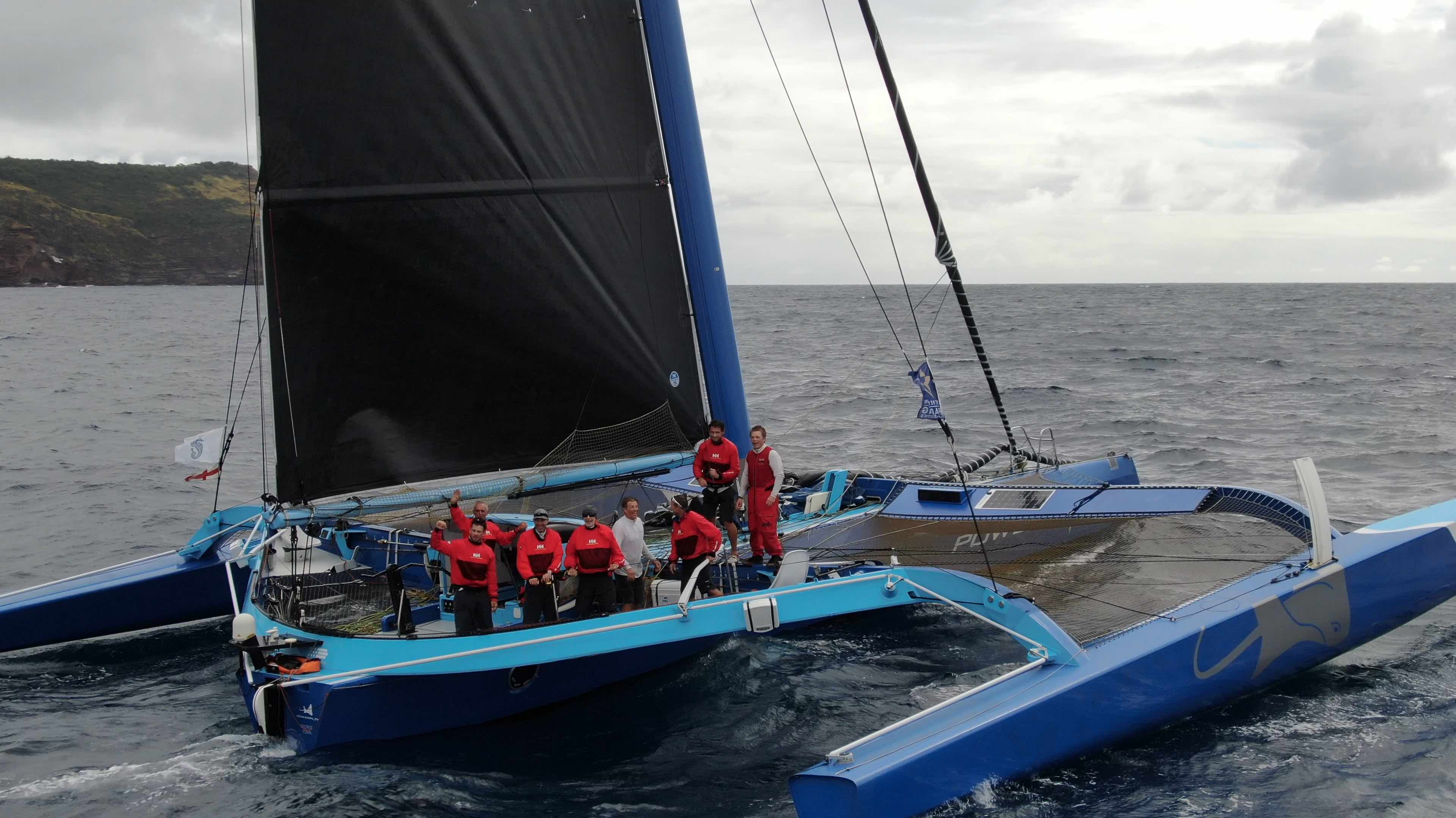 Peter Cunningham's MOD70 arrives in Antigua and the team celebrate their close victory in the MOCRA class after completing the course in 1 day 21 hrs 51 mins 34 secs © RORC